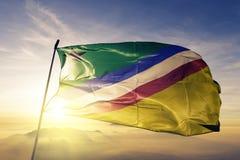 Elias Pina Province of Dominican Republic flag textile cloth fabric waving on the top sunrise mist fog. Beautiful stock image