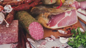 Elicious and varied meat dishes lying on the table. Delicious variety of meats on table stock video footage