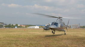 Нelicopter landing in field stock video footage
