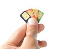 Eligiendo el mejor sim carde o abastecedor celular Imágenes de archivo libres de regalías