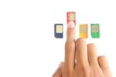 Eligiendo el mejor sim carde o abastecedor celular Foto de archivo libre de regalías