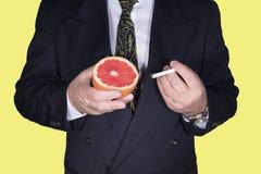Elija entre la salud y fumar Imagen de archivo libre de regalías
