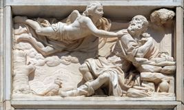 Elijah in the Wilderness, marble relief on the facade of the Milan Cathedral. Duomo di Santa Maria Nascente, Milan, Lombardy, Italy royalty free stock images