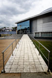 Elimination of architectonic barriers. Approach ramp for handicapped people in a public building Royalty Free Stock Photos