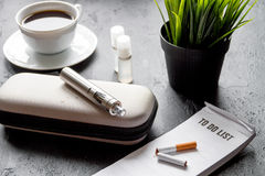 Elimination of tobacco smoking electronic cigarette on dark background Royalty Free Stock Photo