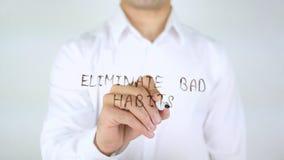 Elimine os hábitos maus, escrita do homem no vidro imagem de stock royalty free