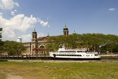 Ellis Island with Statue Cruises ferry boat Royalty Free Stock Image
