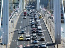 Elisabeth bridge in Budapest in diminishing perspective. With heavy car traffic and shadows in bright sunlight in early hours in the morning over the Danube stock photos