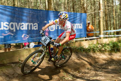 Elisabeth OSL during XCO practice. PIETERMARITZBURG, SOUTH AFRICA - MARCH 17: Elisabeth OSL negotiating a berm during Round 1 of XCO UCI Mountain Bike World Cup Stock Photos