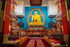 ELISTA, KALMYKIA, RUSSIA - APRIL 24, 2017: Buddhist temple interior. Statue of seated Buddha stock images