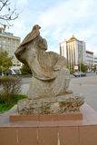 ELISTA, RUSSIA - APRIL 18, 2017: A sculpture of `Berkutchi` against the background of shopping center `Galereya` stock image