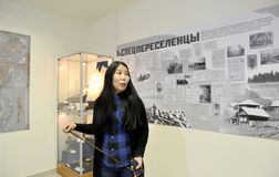 ELISTA, RUSSIA. The girl guide in museum department `Deportation of the Kalmyk people`. National museum of Kalmykia of N.N. Palmo. ELISTA, RUSSIA - APRIL 22 royalty free stock photography