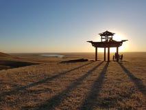 Buddhist pagoda at sunset. Elista, Russia. Lone Poplar Tree stock images