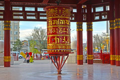 ELISTA, RUSSIA. A prayer wheel with a mantra of Ohms of Manya Padme Hum in a pagoda of Seven Days. ELISTA, RUSSIA - APRIL 18, 2017: A prayer wheel with a mantra Royalty Free Stock Photo