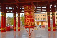 ELISTA, RUSSIA. A prayer wheel with a mantra of Ohms of Manya Padme Hum in a pagoda of Seven Days. ELISTA, RUSSIA - APRIL 18, 2017: A prayer wheel with a mantra Royalty Free Stock Photos