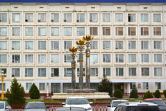 ELISTA, RUSSIA. The Sacred Lotus fountain against the background of the building of the National Hural Parliament of the Republi Stock Images
