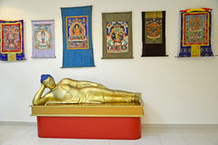ELISTA, RUSSIA. A sculpture of the lying Buddha  Shakyamuni and fabric icons tanks. National museum of Kalmykia of N. N. Palmov Stock Photography
