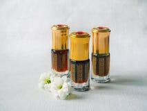 Arabian oud attar perfume or agarwood oil fragrances in mini bottles. Elite Arab perfume in a crystal bottle. Attar Oud oil Stock Images