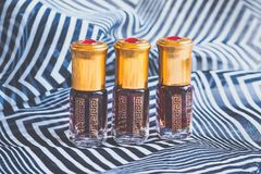 Arabian oud attar perfume or agarwood oil fragrances in mini bottles. Elite Arab perfume in a crystal bottle. Attar Oud oil Royalty Free Stock Photography