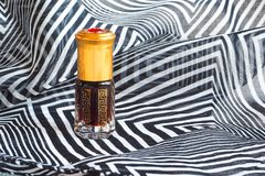 Arabian oud attar perfume or agarwood oil fragrances in mini bottles. Elite Arab perfume in a crystal bottle. Attar Oud oil Royalty Free Stock Images