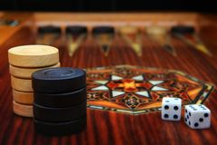 Backgammon game wooden studio quality light. Elite backgammon game wooden studio quality light Royalty Free Stock Photography