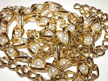 Elite jewelry gold chain and pearls. On the white Royalty Free Stock Image
