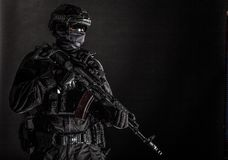 Elite police squad member in tactical ammunition royalty free stock photography