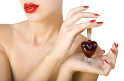 Elixir of Love (love spell). Beautiful woman with red lipstick and red nail polish holding elixir of Love stock photo