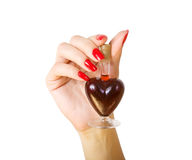 Elixir of Love (love spell). Female hand holding elixir of Love royalty free stock image
