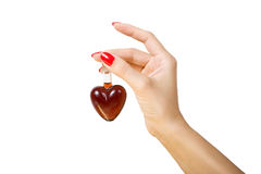 Elixir of Love (love spell). Female hand holding elixir of Love, Isolated on white background stock photo
