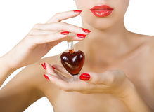 Elixir of Love (love spell). Woman with red lipstick and red nail polish holding elixir of Love royalty free stock photos