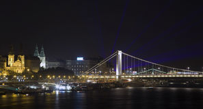 Elizabeth bridge with laser rays in Budapest. Elizabeth bridge with laser rays on the evening sky in Budapest, Hungary Royalty Free Stock Photos