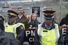 Elizabeth May and Kennedy Stewart arrested at the Kinder Morgan tank farm in Burnaby, BC royalty free stock photography