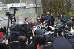 Elizabeth May arrested at the Kinder Morgan protest site in Burnaby, BC. Elizabeth May, leader of the Green Party, and NDP MP Kennedy Stewart listen as a police royalty free stock photography