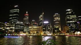 Elizabeth Quay marina night. Perth, Australia - Jan 5, 2018: Esplanade with modern skyscrapers and construction cranes reflecting on the Swan River from stock footage