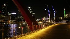 Elizabeth Quay Pedestrian Bridge. Perth, Australia - Jan 5, 2018: POV walking on wooden Elizabeth Quay bridge illuminated by night at Elizabeth Quay Marina stock footage