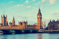 Elizabeth Tower, Big Ben and Westminster Bridge in early morning light, London, England, UK.  Royalty Free Stock Images