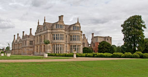 Elizabethan Manor House. A view of the Bay Windows & West Lodge of Kirby Hall, Northamptonshire, England. The hall was built by the Stafford family over the stock image