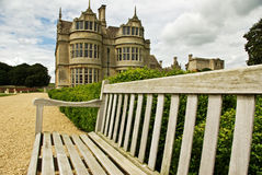 Elizabethan mansion. A bench provides a great vantage point to view the garden of this Elizabethan mansion royalty free stock photography
