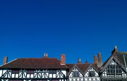 Elizabethan Tudor Style House Rooftops, Stratford Upon Avon, England. Photo of a row of Elizabethan Tudor style black and white old houses, taken in Stratford Royalty Free Stock Photo