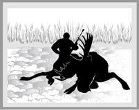 Elk hunter. Hunter Shoot the moose and sits next to his prey Royalty Free Stock Photos