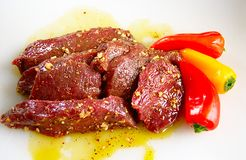 Elk steaks in marinade Stock Images