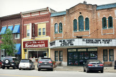 Elkhorn, Wisconsin. Downtown Elkhorn, Wisconsin with the Elk Restaurant Cafe and the Lakeland Players Cinema and an add for the Elkhorn Farm Market. Cars are royalty free stock photography