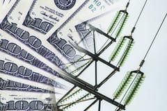 Elkraft och trådar på en bakgrund av pengar Fotografering för Bildbyråer