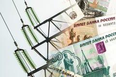 Elkraft och trådar på en bakgrund av pengar Royaltyfria Foton