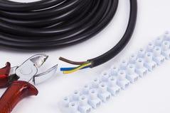 Elkrafthjälpmedel och kabel Arkivfoton