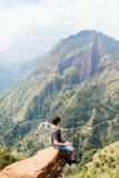 Ella gap views. Young man enjoying breathtaking views over mountains and tea plantations from Little Adams peak in Ella Sri Lanka Stock Images