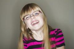 Ella sonríe feliz Imagen de archivo