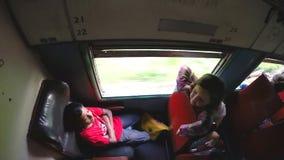 ELLA, SRI LANKA - MARCH 2014: Tourists enjoying train ride through Sri Lankan tea plantation foothills stock video footage