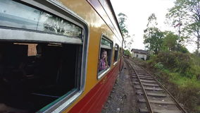 ELLA, SRI LANKA - MARCH 2014: View of Sri Lankan landscape from moving train. stock video footage